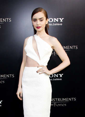 mortal: Lily Collins at the Los Angeles premiere of 'The Mortal Instruments: City Of Bones' held at the Cinerama Dome in Hollywood, USA on August 12, 2013.