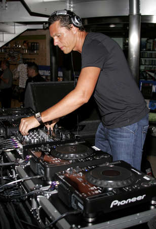 spins: DJ Tiesto, the worlds number 1 trance Deejay spins his set and meets his fans held at the Virgin Megastore in West Hollywood, USA on August 10, 2007.