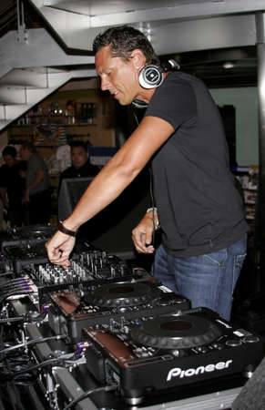 west hollywood: DJ Tiesto, the worlds number 1 deejay performs to his fans held at the Virgin Megastore in West Hollywood, USA on August 10, 2007. Editorial