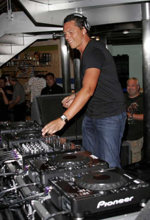 deejay: DJ Tiesto, the worlds number 1 deejay performs to his fans held at the Virgin Megastore in West Hollywood, USA on August 10, 2007. Editorial