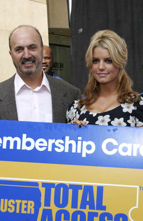 Jessica Simpson and John Antioco, Chairman and CEO of Blockbuster Launch Blockbuster Total Access held at the Kodak Theatre in Hollywood, California, United States on November 2, 2006. Editorial