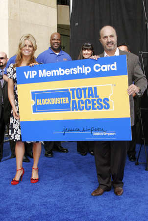 Jessica Simpson and John Antioco, Chairman and CEO of Blockbuster Launch Blockbuster Total Access held at the Kodak Theatre inHollywood, California, United States on November 2, 2006.