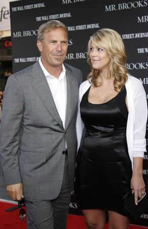 christine: Kevin Costner and wife Christine Baumgartner at the Los Angeles Premiere of Mr. Brooks held at the Graumans Chinese Theater in Hollywood, USA on May 22, 2007. Editorial