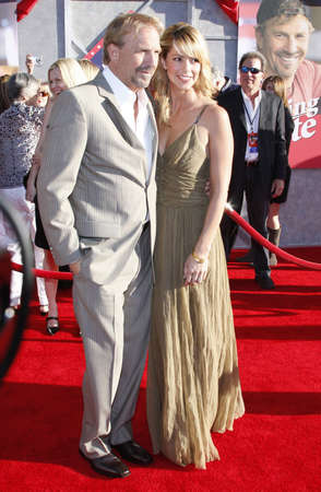 christine: Kevin Costner and wife Christine Baumgartner at the World premiere of Swing Vote held at the El Capitan Theater in Hollywood, USA on July 24, 2008.