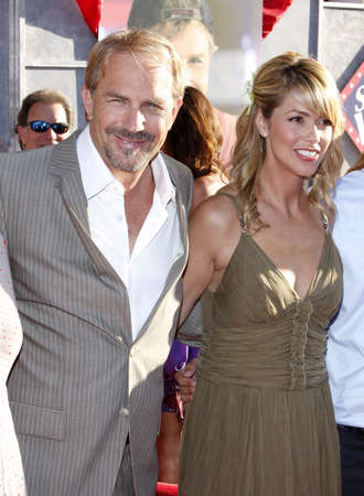 christine: Kevin Costner and Christine Baumgartner at the World premiere of Swing Vote held at the El Capitan Theater in Hollywood, USA on July 24, 2008.
