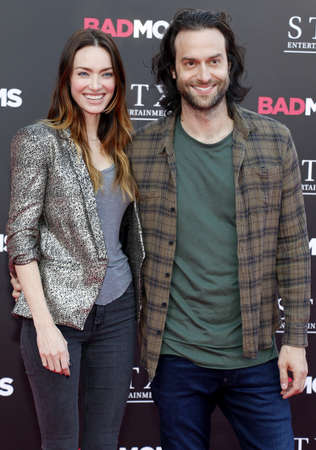 Chris DElia and Cassi Colvin at the Los Angeles premiere of Bad Moms held at the Mann Village Theater in Westwood, USA on July 26, 2016.