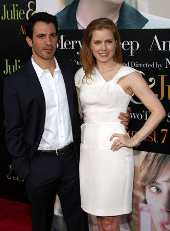 adams: Chris Messina and Amy Adams at the Los Angeles screening of Julie & Julia held at the Mann Village Theater in Westwood, USA on July 27, 2009. Editorial