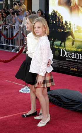 Dakota Fanning and Elle Fanning at the Los Angeles premiere of Dreamer held at the Mann Village Theatre in Westwood, California, United States on October 9, 2005. Editorial