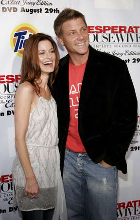savant: Doug Savant and Laura Leighton at the Desperate Housewives: Extra Juicy Edition Season 2 DVD Launch held at the Wisteria Lane Universal Studios in Hollywood, USA on August 5, 2006.