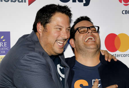 gad: Josh Gad and Greg Grunberg at the 5th Biennial Stand Up To Cancer held at the Walt Disney Concert Hall in Los Angeles, USA on September 9, 2016. Editorial