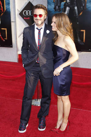 Robert Downey Jr. and Susan Downey at the Los Angeles premiere of 'Iron Man 2' held at the El Capitan Theatre in Hollywood, USA on April 26, 2010. Фото со стока - 124411714