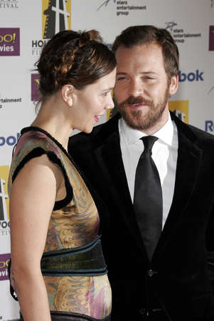 Peter Sarsgaard and Maggie Gyllenhaal at the 2005 Hollywood Film Festival Awards Gala Ceremony held at the Beverly Hilton in Beverly Hills, USA on October 24, 2005.
