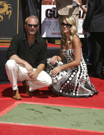 Kevin Costner and Christine Baumgartner at the Kevin Costner Hand and Footprints Ceremony held at the Graumans Chinese Theater in Hollywood, California, United States on September 6, 2006. Editorial