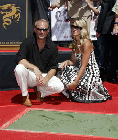 christine: Kevin Costner and Christine Baumgartner at Kevin Costner Hand and Footprints Ceremony held at the Graumans Chinese Theatre in Hollywood, USA on September 6, 2006.