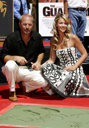 Kevin Costner and Christine Baumgartner at Kevin Costner Hand and Footprints Ceremony held at the Graumans Chinese Theater in Hollywood, California, United States on September 6, 2006. Editorial