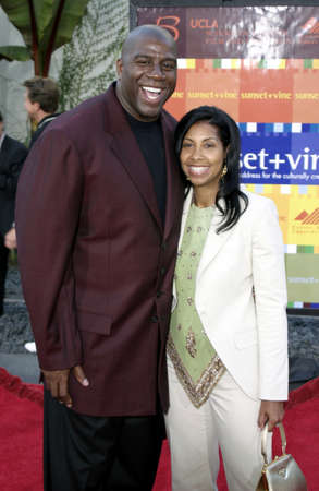 Magic Johnson and Cookie Johnson at the World premiere of 'The Bourne Supremacy' held at the ArcLight Cinema in Hollywood, USA on July 15, 2004.
