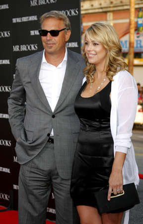 christine: Kevin Costner and wife Christine Baumgartner at the Los Angeles premiere of Mr. Brooks held at the Graumans Chinese Theater in Hollywood, USA on May 22, 2007.
