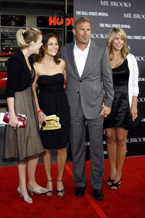 christine: Lily Costner, Annie Costner, Kevin Costner and wife Christine Baumgartner at the Los Angeles premiere of Mr. Brooks held at the Graumans Chinese Theater in Hollywood, USA on May 22, 2007.