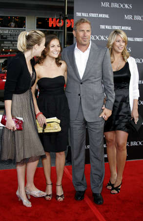annie: Lily Costner, Annie Costner, Kevin Costner and Christine Baumgartner at the Los Angeles premiere of Mr. Brooks held at the Graumans Chinese Theater in Hollywood, USA on May 22, 2007.