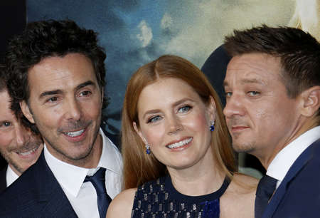 ufos: Shawn Levy, Amy Adams and Jeremy Renner at the Los Angeles premiere of Arrival held at the Regency Village Theater in Westwood, USA on November 6, 2016.