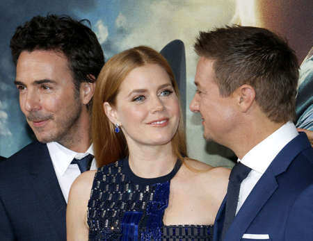 ufos: Shawn Levy, Jeremy Renner and Amy Adams at the Los Angeles premiere of Arrival held at the Regency Village Theater in Westwood, USA on November 6, 2016.
