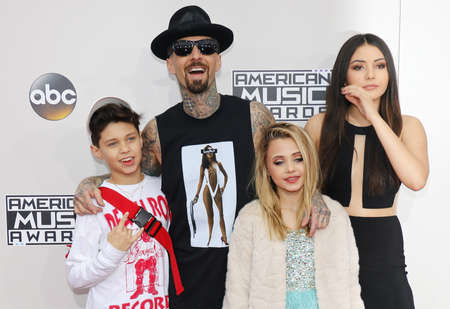 asher: Landon Asher Barker, Travis Barker, Alabama Luella Barker and Atiana de la Hoya at the 2016 American Music Awards held at the Microsoft Theater in Los Angeles, USA on November 20, 2016.