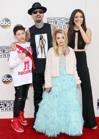 Landon Asher Barker, Travis Barker, Alabama Luella Barker and Atiana de la Hoya at the 2016 American Music Awards held at the Microsoft Theater in Los Angeles, USA on November 20, 2016.