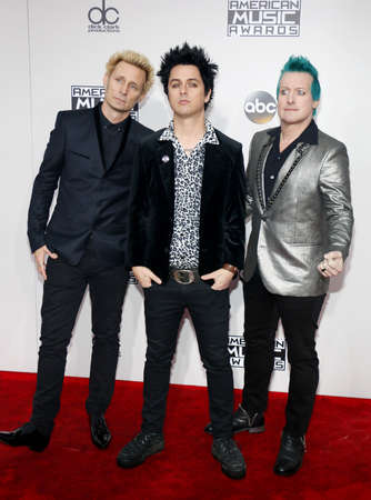 Billie Joe Armstrong, Tre Cool and Mike Dirnt of Green Day at the 2016 American Music Awards held at the Microsoft Theater in Los Angeles, USA on November 20, 2016.