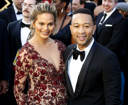 Chrissy Teigen and John Legend at the 88th Annual Academy Awards held at the Hollywood & Highland Center in Hollywood, USA on February 28, 2016. Editorial