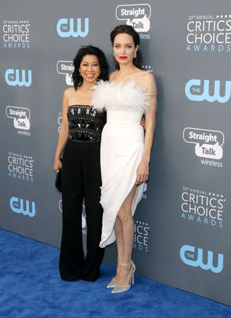 Loung Ung and Angelina Jolie at the 23rd Annual Critics Choice Awards held at the Barker Hangar in Santa Monica, USA on January 11, 2018.
