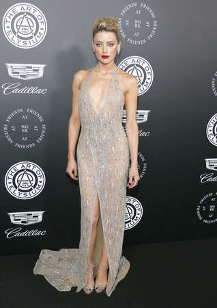 Amber Heard at the Art Of Elysiums 11th Annual Heaven Celebration held at the Barker Hangar in Santa Monica, USA on January 6, 2018.