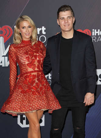 Chris Zylka and Paris Hilton at the 2018 iHeartRadio Music Awards held at the Forum in Inglewood, USA on March 11, 2018. Editorial