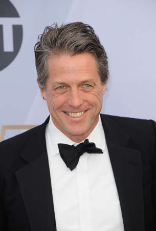 Hugh Grant at the 25th Annual Screen Actors Guild Awards held at the Shrine Auditorium in Los Angeles, USA on January 27, 2019. Éditoriale