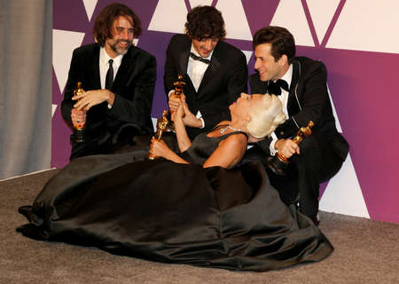 Andrew Wyatt, Anthony Rossomando, Lady Gaga and Mark Ronson at the 91st Annual Academy Awards - Press Room held at the Loews Hotel in Hollywood, USA on February 24, 2019.