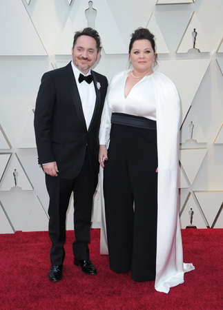 Melissa McCarthy and Ben Falcone at the 91st Annual Academy Awards held at the Hollywood and Highland in Los Angeles, USA on February 24, 2019. Archivio Fotografico - 117944600