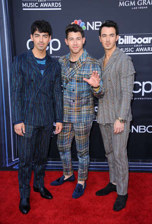 Joe Jonas, Nick Jonas and Kevin Jonas at the 2019 Billboard Music Awards held at the MGM Grand Garden Arena in Las Vegas, USA on May 1, 2019. 新聞圖片