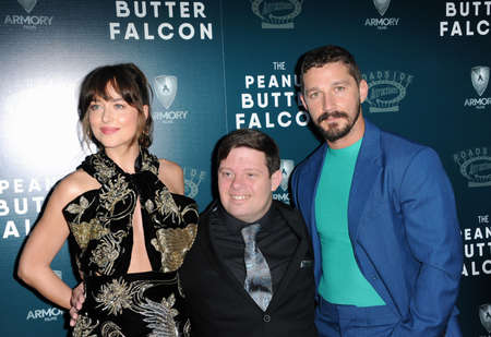 Dakota Johnson, Zack Gottsagen and Shia LaBeouf at the Los Angeles premiere of 'The Peanut Butter Falcon' held at the ArcLight Cinemas in Hollywood, USA on August 1, 2019.