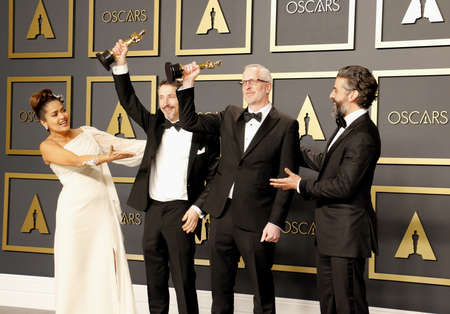 Mark Taylor, Stuart Wilson, Salma Hayek and Oscar Isaac at the 92nd Academy Awards - Press Room held at the Dolby Theatre in Hollywood, USA on February 9, 2020. 写真素材 - 144733250