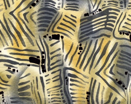 Fashion fabric with fanciful African pattern in yellow and deep blue.  photo