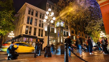 Vancouver, British Columbia - Canada. Downtown iconic landmark on a chilly night just after a rain, the Steam Clock, Gastown- Vancouver, British Columbia, Canada. Stock Photo