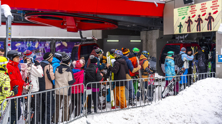 Poiana Brasov, Romania. 01. 03. 2019. People waiting in line to get into gondolas at a famous ski resort. Editorial
