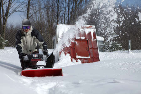 snow blowing man photo