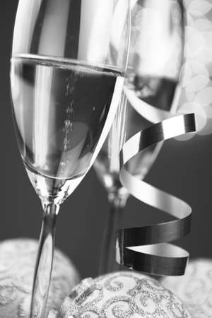 Christmas glasses of Champagne and golden background photo