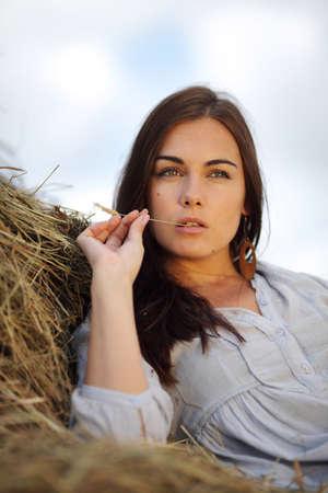 beautiful girl on stack of hay Reklamní fotografie