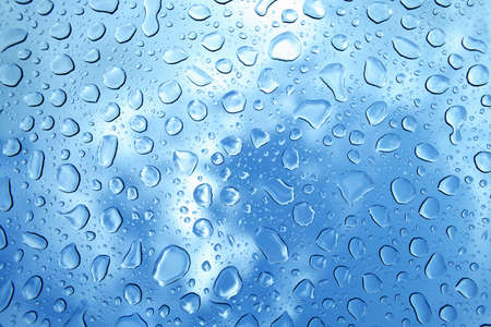condensate: water drops on glass against blue sky Stock Photo