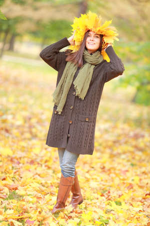 beatitude: Beautiful woman in autumn wreath on a head