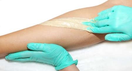 epilation with liquate sugar at legs photo