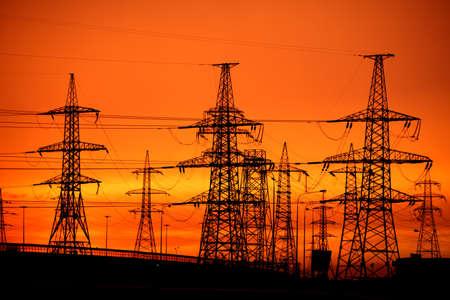 Linia moc transmisji na zachód słońca Zdjęcie Seryjne