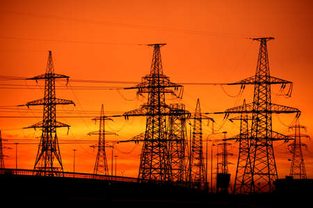 tense: transmission power line on sunset Stock Photo
