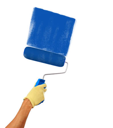 platen: Mans hand holding a paint roller drawing with a blue paint isolated on a white background